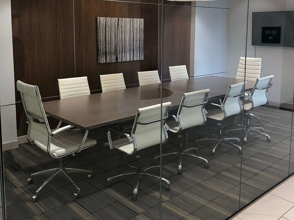 The board room with white leather chairs at Disability Attorneys of Arizona Roeschke Law