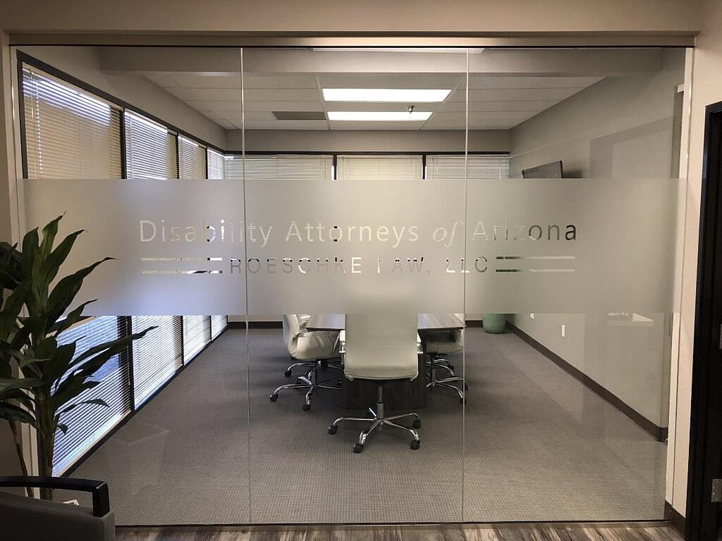 A view of the board room with white leather chairs at Disability Attorneys of Arizona Roeschke Law