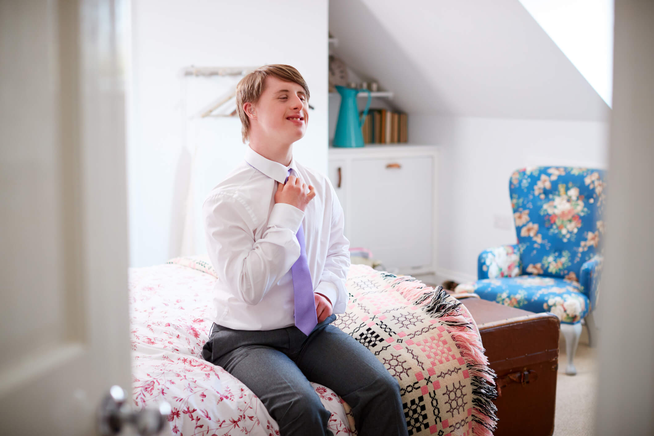Young man with Down Syndrome, getting ready for work.