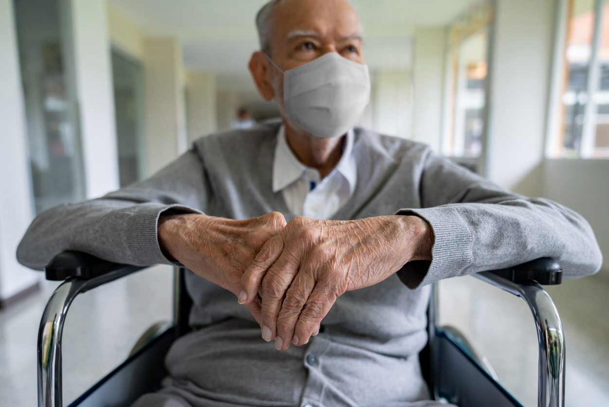 Disabled man with a mask on to prevent COVID-19