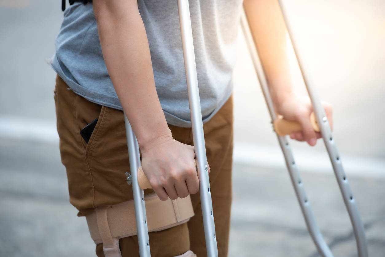 Disabled woman with crutches.