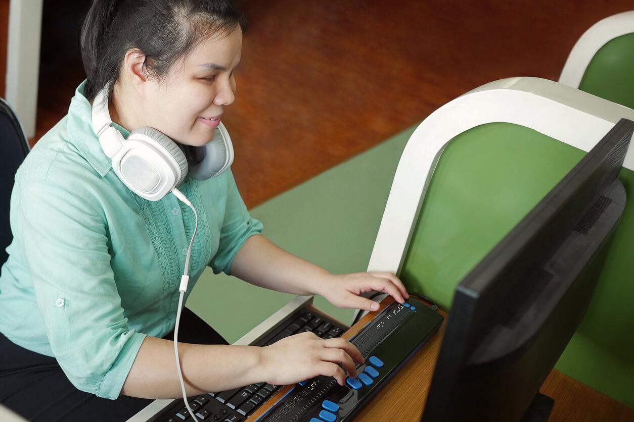 special needs child doing schoolwork