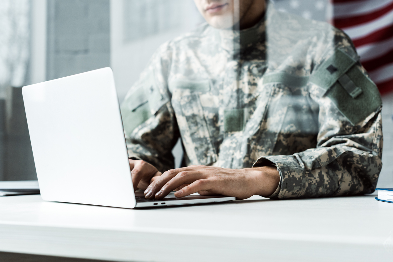 military officer on computer