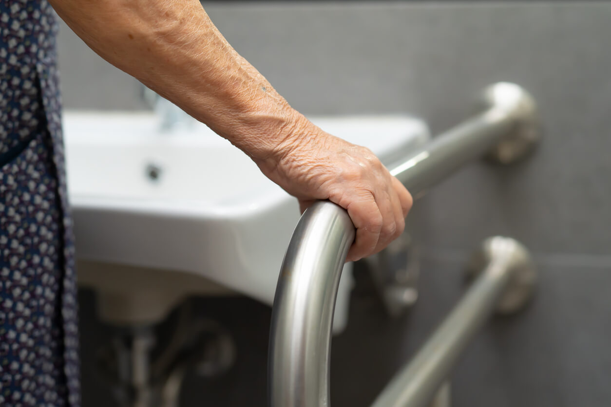 disabled person holding railing